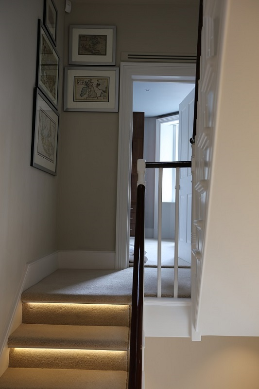 A lighting control system illuminating stairs up to a bedroom