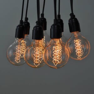 A dimmed squirrel cage light bulb.