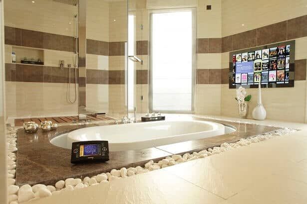 A Bathroom Mirror TV is controlled by a Crestron Touchpanel