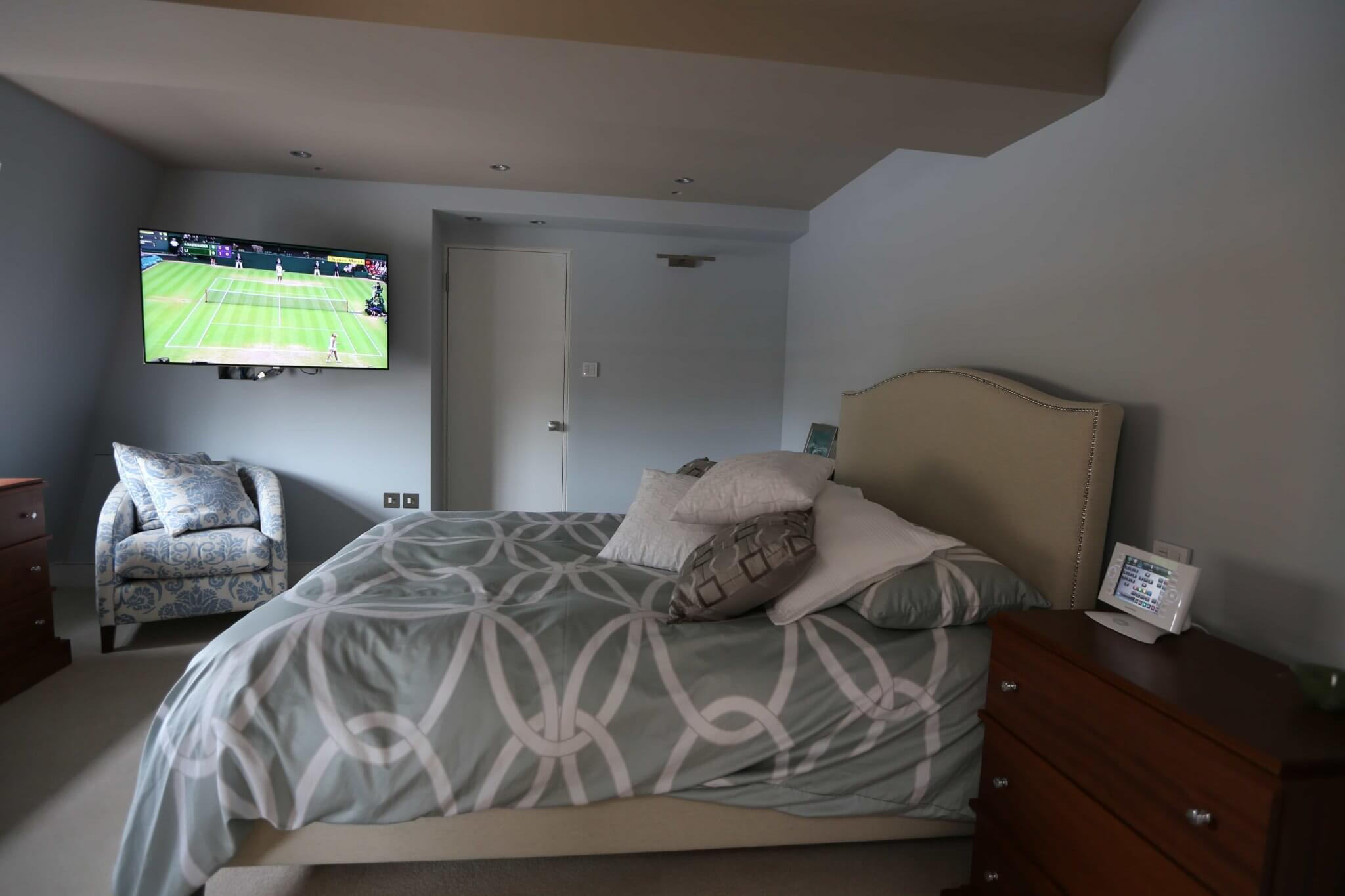 Floating TV in Bedroom as part of Crestron Whole Home System